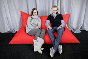 Two young polish entrepreneurs portrait while sitting on one of the large pillows that they produce.
