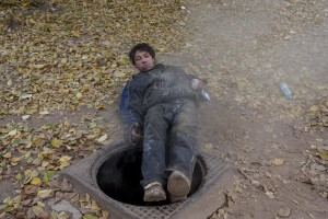A man is portrayed after the use of aurolac drug near Gara de Nord in Bucharest, Romania on November 6, 2011. During the winter hundreds of persons, sleep in the basement of the city to find heat.