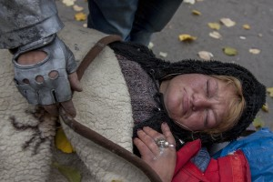 A woman with a gangrenous finger sleeps on a bench near Gara de Nord in Bucharest, Romania on November 6, 2011. During the winter hundreds of persons, sleep in the basement of the city to find heat.