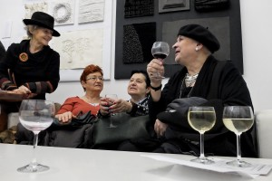 "People drinking wine during the opening of an art exhibition at the gallery ""Salon Akademii"" in Warsaw on February 18, 2014."