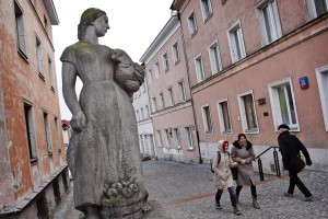 People walking in the streets of the old town in Warsaw on February 13, 2014.
