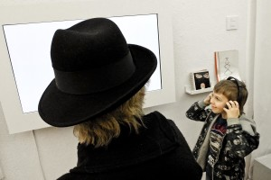 "A woman and a child admire an 'installation during the opening of an art exhibition at the gallery ""Salon Akademii"" in warsaw on February 18, 2014."