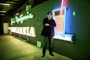 """A portrait of David Hill, founder and director of """"Neon Muzeum"""" in Warsaw on February 16, 2014. The museum, which was launched in 2005 with the purpose of saving the neon lights and neon signs of the post-war period, is based in the """"Soho Factory"""" in the neighborhood """"Prague"""", the creative heart of Warsaw."""