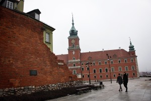 People walking near Plac Zamkowy in the historic center of Warsaw on February 13, 2014.