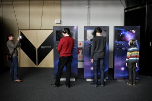 "People struggling with interactive experiments at the ""Centrum Nauki Kopernik"" in Warsaw on February 14, 2014. The building dedicated to Copernicus is located in the center of the capital and features interactive exhibitions, a planetarium and a conference center."