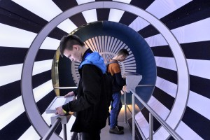 "Two boys play with interactive experiments at the ""Centrum Nauki Kopernik"" in Warsaw on February 14, 2014. The building dedicated to Copernicus is located in the center of the capital and features interactive exhibitions, a planetarium and a conference center."