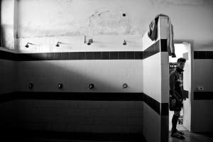 "A player of ""Nuova Quarto Calcio per la Legalità"" football team in the dressing room after a training at the local stadium of Quarto, in Italy on March 7, 2013. The team of Quarto, once under the control of Polverino camorra organization, has now become a legality symbol."