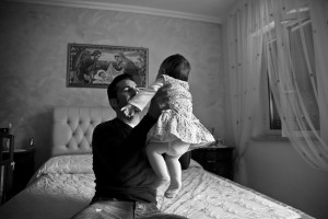 "Franco Palma, player of ""Nuova Quarto Calcio per la Legalità"" football plays with his daughter at home in Quarto, Italy on April 24, 2013. The team of Quarto, once under the control of Polverino camorra organization, has now become a legality symbol."