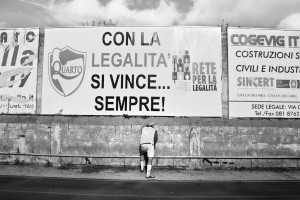 "A player of ""Nuova Quarto Calcio per la Legalità"" football team near the  write ""Con la legalità si vince sempre"" who means ""with the law always wins"" during a match at the local stadium of Quarto, in Italy on April 20, 2013. The team of Quarto, once under the control of Polverino camorra organization, has now become a legality symbol."