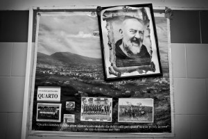 "A big poster of Padre Pio is attached in the dressing room of ""Nuova Quarto Calcio per la Legalità"" football team at the local stadium of Quarto, in Italy on March 5, 2013. The team of Quarto, once under the control of Polverino camorra organization, has now become a legality symbol."