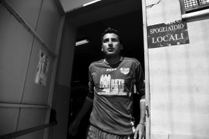 "Luca Tucci, player of ""Nuova Quarto Calcio per la Legalità"" football team go outside the dressing room before an official match at the local stadium of Quarto, in Italy on April 28, 2013. The team of Quarto, once under the control of Polverino camorra organization, has now become a legality symbol."