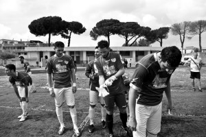 "Players of ""Nuova Quarto Calcio per la Legalità"" football team enter the field during an offical match at the local stadium of Quarto in Italy on April 20, 2013. The team of Quarto, once under the control of Polverino camorra organization, has now become a legality symbol."