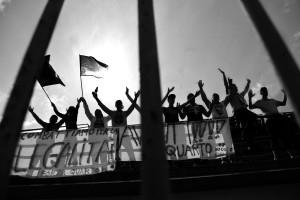 "Supporters of ""Nuova Quarto Calcio per la Legalità"" football team at the local stadium of Quarto, in Italy on April 20, 2013. The team of Quarto, once under the control of Polverino camorra organization, has now become a legality symbol."