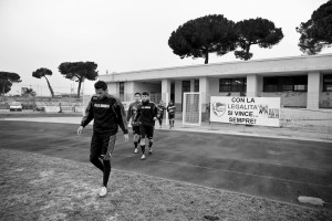 "Players of ""Nuova Quarto Calcio per la Legalità"" football team go outside the dressing room before a training at the local stadium of Quarto, in Italy on March 5, 2013. The team of Quarto, once under the control of Polverino camorra organization, has now become a legality symbol."