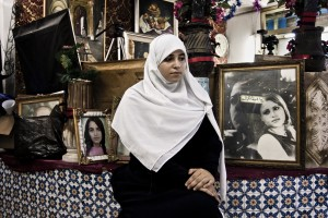 Sirine (18 years) portrayed in the photo studio where he works as a secretary in Tunis on October 12, 2012.