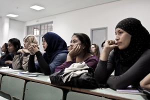 """Students follow a lesson at University """"La Monouba"""" in Tunis on October 17, 2012."""