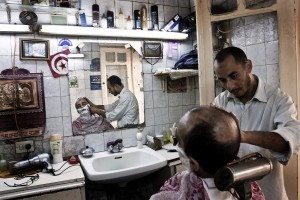 A man in a salon shaving in the heart of the old city in Tunis on October 21, 2012.