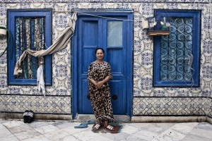 The portrait of a  woman in front of  the entrance of his house in the medina of Halfaouine in Tunis on October 10, 2012.