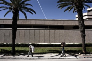Two workers carrying goods along Avenue Mohamed V in Tunis on October 18, 2012.
