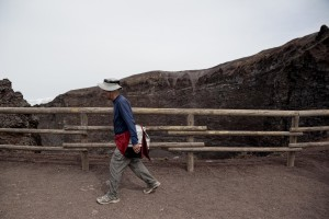 A tourist on the pedestrian path of Vesuvius cone in Naples, Italy on September 9, 2013.