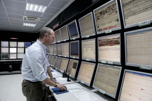 A technician inside the monitoring room of INGV (National Institute Geophysics and Volcanology) Osservatorio Vesuviano department which constantly monitors volcanic activity of mount Vesuvius, Campi Flegrei, Ischia island and Stromboli island in Naples, Italy on March 19, 2014.