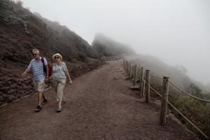 Tourists on the pedestrian path of Vesuvius cone in Naples, Italy on September 9, 2013.