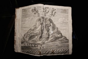 "An old book with a picture of Vesuvius volcano during the exhibition ""Fire and Passion"" at Museum of San Gennaro treasure in Naples, Italy on January 18, 2014."