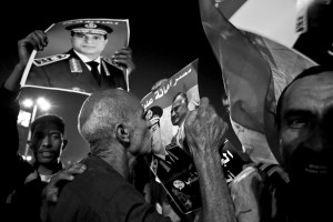 July 19, 2013 – Cairo, Egypt: Anti-Morsi demonstrators show photos of general el-Sisi at Tahrir Square.