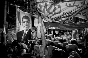 July 12, 2013 – Cairo, Egypt: Supporters of former President Mohammed Morsi pray in Raba square.