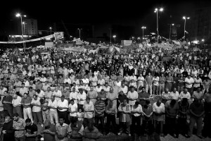 July 15, 2013 – Cairo, Egypt: Anti-Morsi demonstrators pray at Tahrir Square.