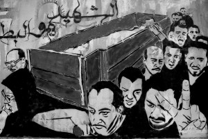 July 14, 2013 – Cairo, Egypt: A mural shows the funeral of a person killed during the Egyptian revolution of 2011.
