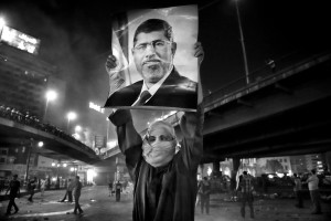 July 15, 2013 – Cairo, Egypt: A supporter of the Muslim Brotherhood and of Egypt's ousted President Mohamed Morsi during a demonstration under the Six October Bridge in the center of Cairo. The demonstrators demanding the reinstatement of Morsi clashed with riot police as they tried to block the bridge, one of the main highways in the capital.