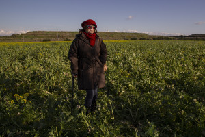 January 28, 2014 – Giugliano, Italy: The activist Lucia De Cicco portrayed in the so-called area Vasto, full of toxic waste underground and illegal dumps close to the farmlands. Lucia, during a protest of 2008 against the re-opening of the storage site Taverna del Re, set herself on fire.