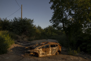 """A burned car is seen close to the farmlands of Qualiano, Southern Italy on September 17, 2019. The area is part of the so-called """"land of fires"""", a site of toxic and illegal waste dump."""