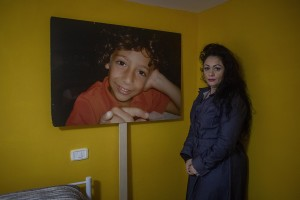 The environmental activist Marzia caccioppoli, 45 years old is portrayed next to a blow-up of his son Antonio in Casalnuovo, Southern Italy on February 26, 2021. Antonio died at the age of 9 after falling ill with glioblastoma multiforme, a disease that according to his mother would have arisen due to the environmental pollution strongly present in the land of fires.