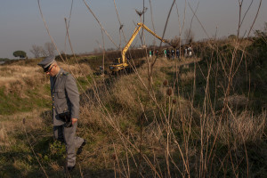 January 13, 2014 – Villa di Briano, Italy: A forester digs in a field that, according to repent of Camorra, was used as a toxic waste dump near Caserta.