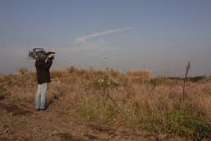 January 13, 2014 – Villa di Briano, Italy: A cameraman records a field that, according to repent of Camorra, was used as a toxic waste dump near Caserta.