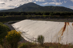 """May 23, 2015 – Terzigno, Italy: A general view of Cava Sari landfill, a collection site of non-recyclable dry waste in """"Pozzelle"""". Cava Sari, located in the Vesuvius National Park in an old quarry of lava stone, currently holds 972,000 cubic meters of waste (among which there may be also radioactive waste) in front of a capacity of 730,000 cubic meters, characterized by being one of the largest landfills in the region."""