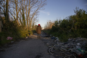 January 28, 2014 – Giugliano, Italy: The activist Lucia De Cicco walks in the so-called area Vasto, full of toxic waste underground and illegal dumps close to the farmlands. Lucia, during a protest of 2008 against the re-opening of the storage site Taverna del Re, set herself on fire.