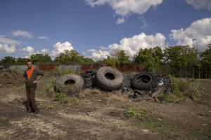 October 7, 2013 – Scisciano, Italy: A man is portrayed inside the so-called cemetery of tires where hundreds of wheels are piled.