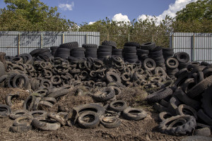 October 7, 2013 – Scisciano, Italy: Hundreds of wheels piled in the so-called cemetery of tires.