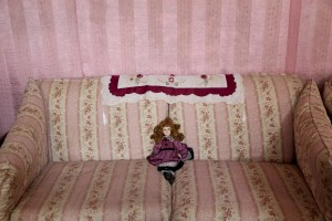 A doll on the sofa of Marina house in Rufoli on March 17, 2015. Marina Rinaldi is the first ex trans in the world to coach a soccer team.