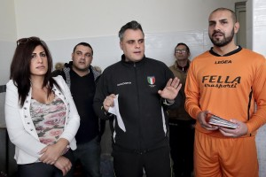 Marina Rinaldi in the locker room during the recognition of players made by referee before the championship match against Pro Casolla in Nocera Inferiore, south Italy, on March 1, 2015. Marina Rinaldi is the first ex trans in the world to coach a soccer team.