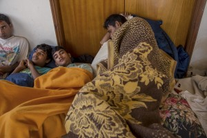 Afghans migrants rests in an abandoned hotel where many migrants sleep in Kos island, Greece on June 8, 2015. Many migrants are continuing to arrive on the Greek Island of Kos from Turkey. The Island has recently seen a drop in tourist numbers which has been attributed to negative reports on the migrant crisis that is continuing to grip the area. Around 30,000 migrants have entered Greece so far in 2015, with the country calling for more help from its European Union counterparts.