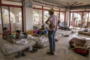 Pakistani migrants are seen in an abandoned hotel where many migrants sleep in Kos island, Greece on June 15, 2015. Many migrants are continuing to arrive on the Greek Island of Kos from Turkey. The Island has recently seen a drop in tourist numbers which has been attributed to negative reports on the migrant crisis that is continuing to grip the area. Around 30,000 migrants have entered Greece so far in 2015, with the country calling for more help from its European Union counterparts.