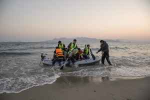 A group of Pakistani migrants arrive on the beach in a dinghy at dawn after making their way from Turkey in Kos island, Greece on June 14, 2015. Many migrants are continuing to arrive on the Greek Island of Kos from Turkey. The Island has recently seen a drop in tourist numbers which has been attributed to negative reports on the migrant crisis that is continuing to grip the area. Around 30,000 migrants have entered Greece so far in 2015, with the country calling for more help from its European Union counterparts.