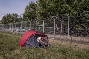 A migrant near the border that divides Serbia and Hungary in Horgos, Serbia on September 16, 2015. Hungary's border with Serbia has become a major crossing point into the European Union for migrants, with more than 160,000 accessing Hungary so far this year.