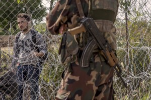 A migrant is seen near the Serbian border with Hungary in Rozske, Hungary on September 15, 2015. The right-wing nationalist government led by Viktor Orbán has closed the entire border with Serbia on September 15, 2015 after the entry into force of new rules that make it illegal and punishable by law. Hungary's border with Serbia has become a major crossing point into the European Union, with more than 160,000 access Hungary so far this year.