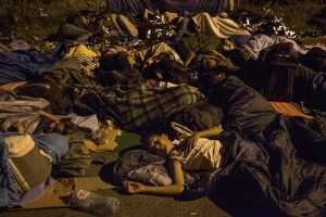 Migrants sleep on the street near the Serbian border with Hungary in Horgos, Serbia on September 15, 2015. Hungary's border with Serbia has become a major crossing point into the European Union for migrants, with more than 160,000 accessing Hungary so far this year.