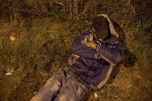 A migrant sleeps on the street near the Serbian border with Hungary in Horgos, Serbia on September 15, 2015. Hungary's border with Serbia has become a major crossing point into the European Union for migrants, with more than 160,000 accessing Hungary so far this year.